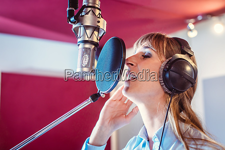 singer in a professional sound studio