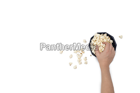 hand holding popcorn isolated on the