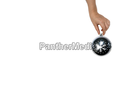 christmas ball in hand isolated on