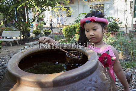 young girl checks out the water