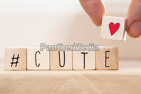 wooden cubes with hashtag the word