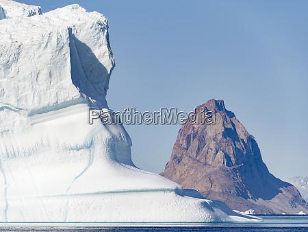 uummannaq island and icebergs in the