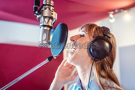 singer in a professional sound studio
