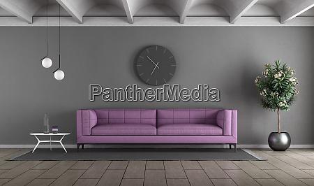 soggiorno con divano viola