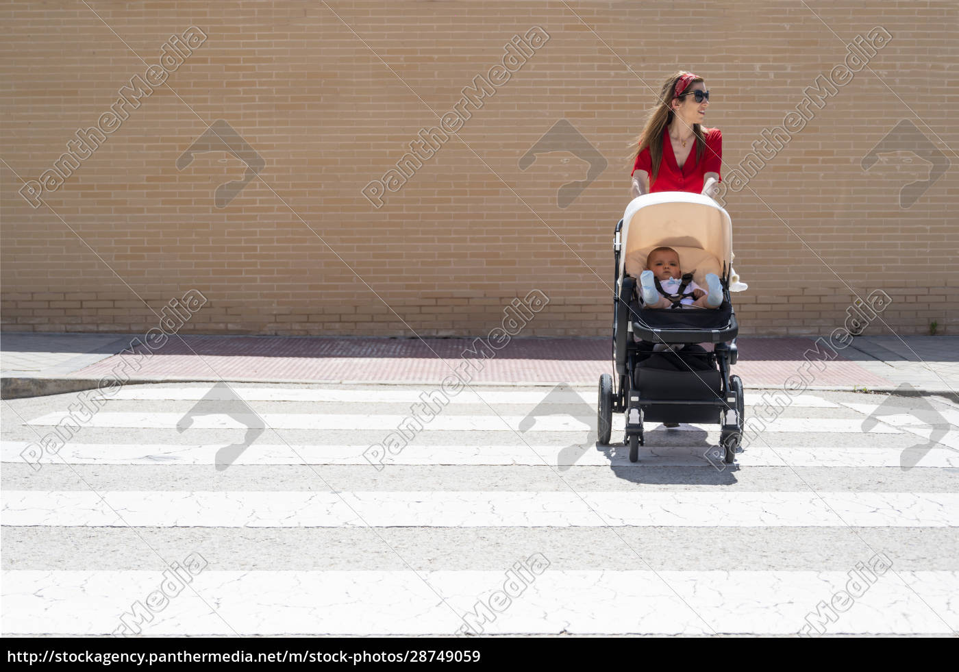 mother, wearing, sunglasses, pushing, son, in - 28749059
