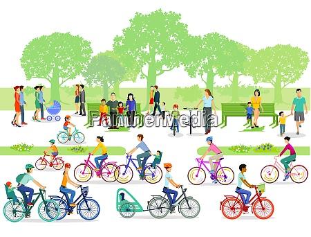 ciclisti e pedoni nel parco