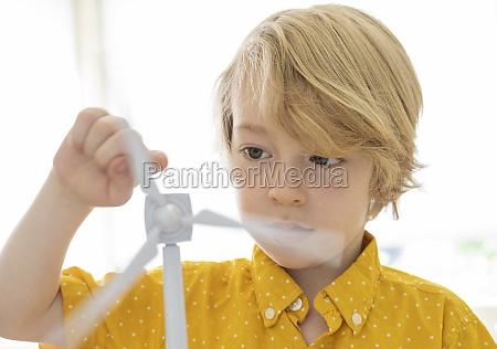 boy, (6-7), playing, with, wind, turbine - 29623322