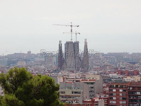 sagrada, familia, with, cranes, and, overcast - 29745781