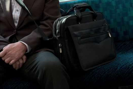 travel, men, business, ethnicity, sitting, down - D13362038